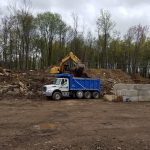 Excavator loading dirt