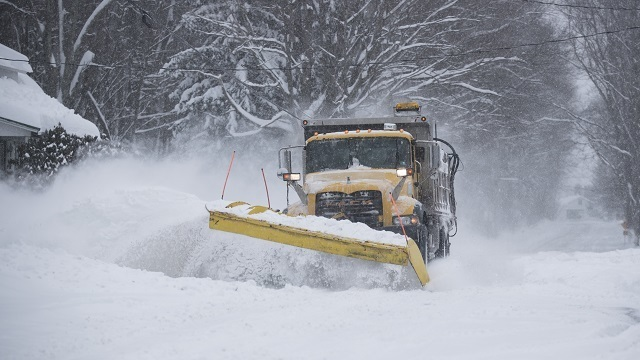 Commercial truck throwing snow
