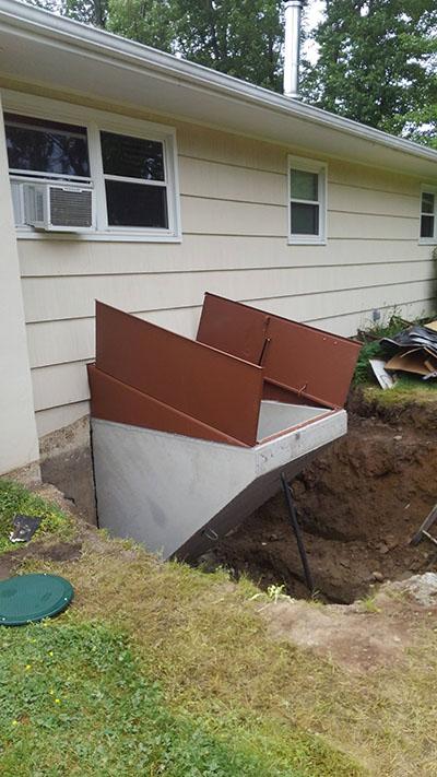 Basement access dug out