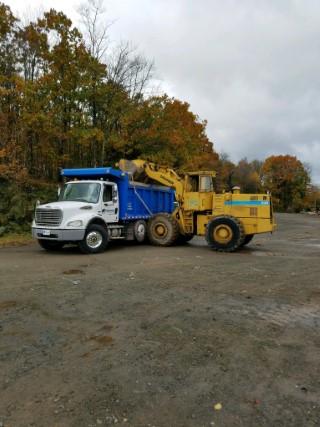 Excavator dirt loading