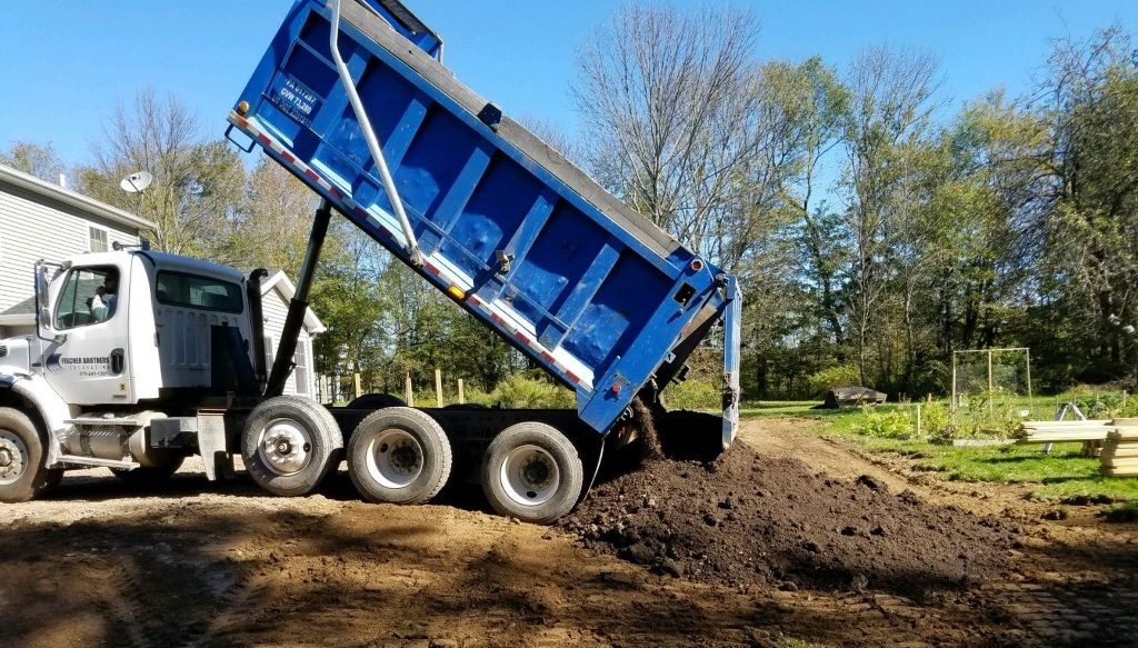 Truck dropping off dirt