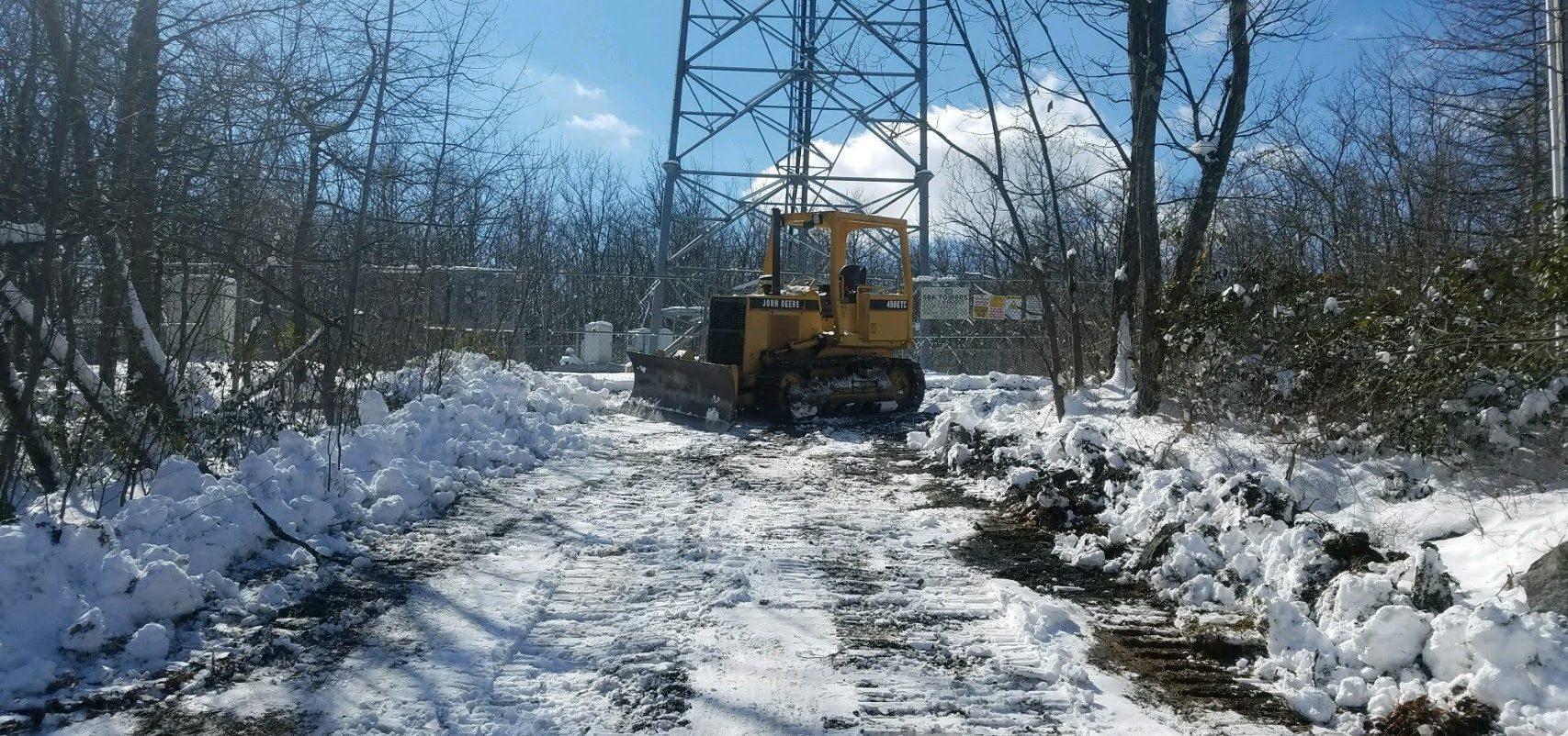 Excavator Woods Snow Removal