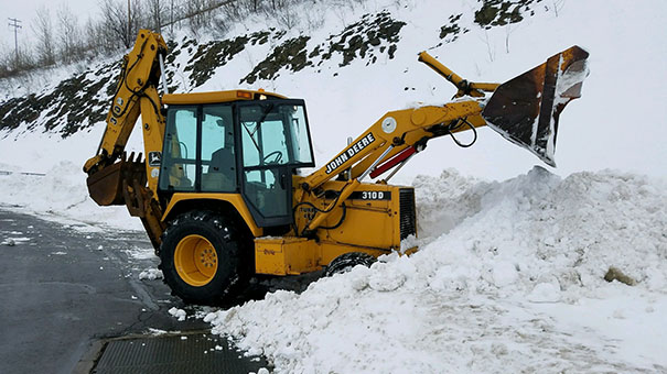 Excavator Snow Piling lot