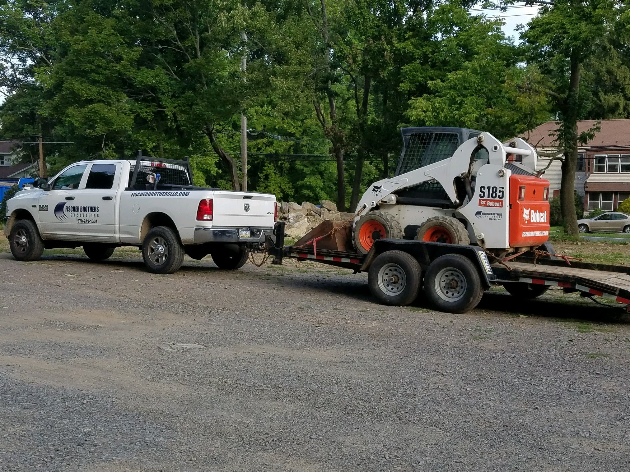 Truck with skidsteer on trailer